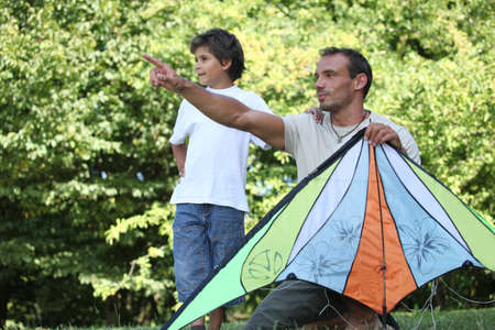 Father and son flying kite photo