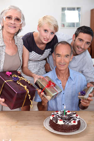 Family celebrating a birthday together photo