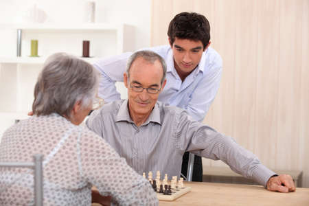 Senior couple playing chess photo