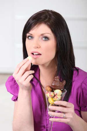Woman eating Easter eggs photo