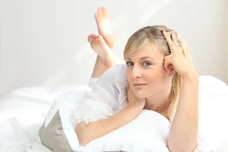 blonde woman at bed photo