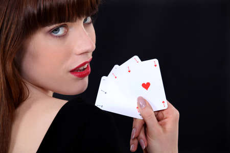 play card: Gorgeous girl showing four aces