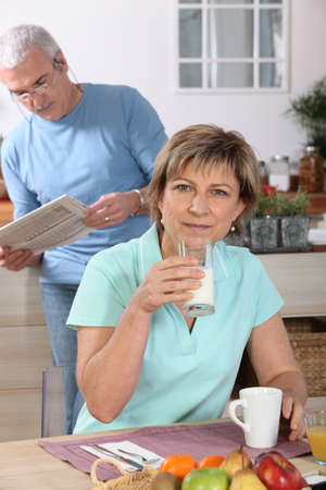 Mature couple drinking milk photo