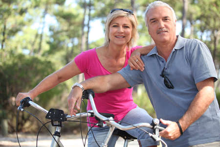 55 to 60: Couple enjoying a bike ride together