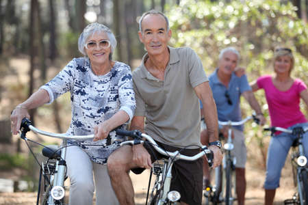 Mature couples on a double date biking. photo