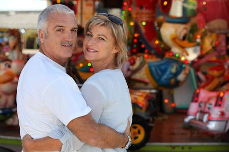arms around: Couple at the fair together