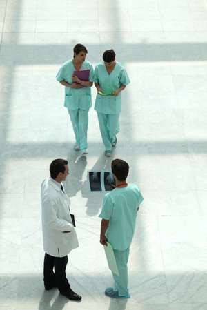 Hospital staff in corridor photo