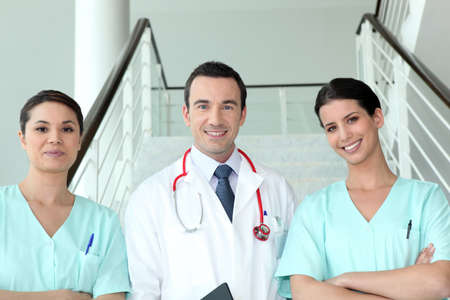 Portrait of two female nurses with doctor Stock Photo - 12097441