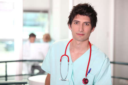 Hospital medic in scrubs with stethoscope photo