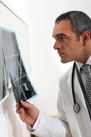 imaging: doctor examining x-ray