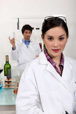 Two scientists making experienced on wine. Stock Photo - 12092899