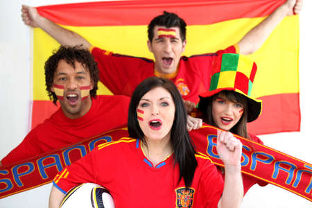 cheering fans: A group of people show their support of the Spanish football team Stock Photo