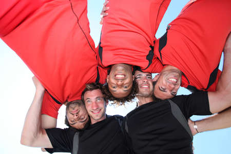 Low-angle shot of five young men playing rugby Imagens