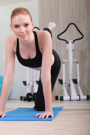 Young woman exercising at the gym photo