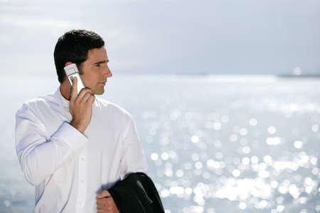 Businessman stood by the sea