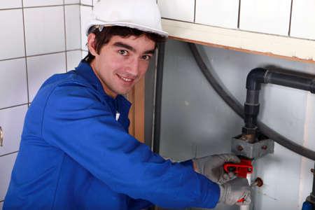 junior plumber at work photo