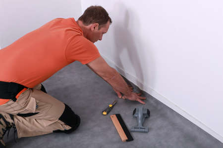 man installing linoleum photo