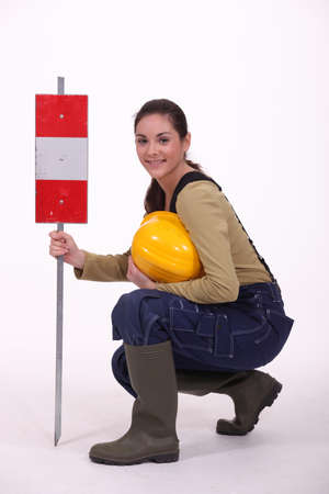 Construction work with a warning sign Stock Photo - 12132353