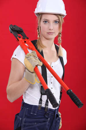 Woman with boltcutters Stock Photo - 12132792