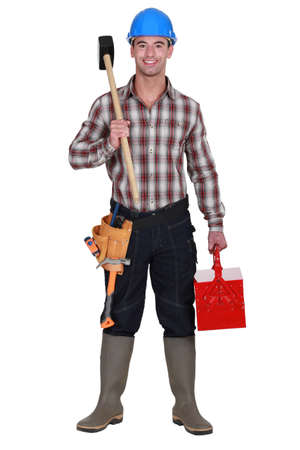 Builder with a sledgehammer Stock Photo