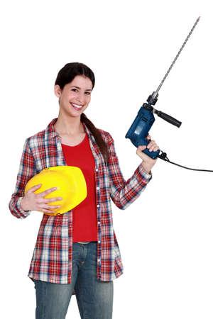 craftswoman: craftswoman holding a drill