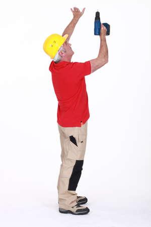 journeyman technician: senior craftsman holding a drill