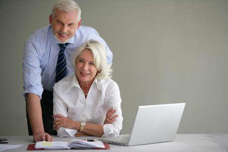 businesswoman suit: Ejecutivos de alta gerencia en la oficina