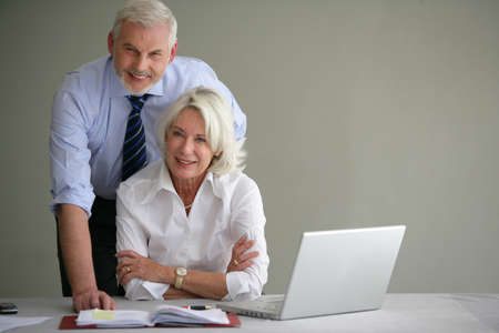 Senior businesspeople in office Stock Photo - 12132400