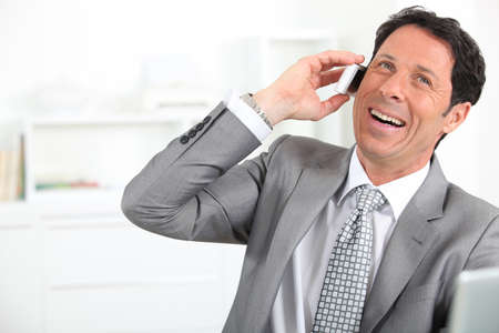 mature man wearing grey suit with tie is laughing Stock Photo - 12133032