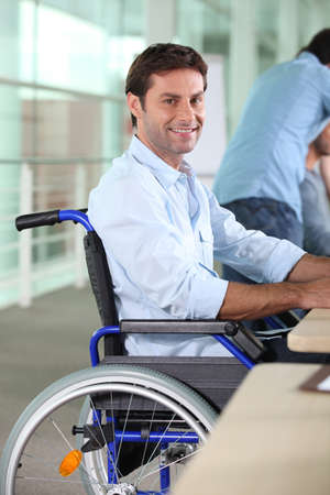 integrated group: Man working in a wheelchair