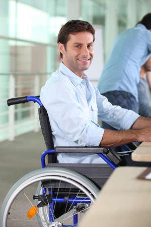 workteam: Man working in a wheelchair