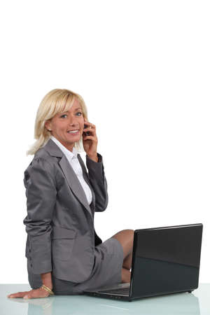 50 55 years: Successful businesswoman talking on her mobile phone