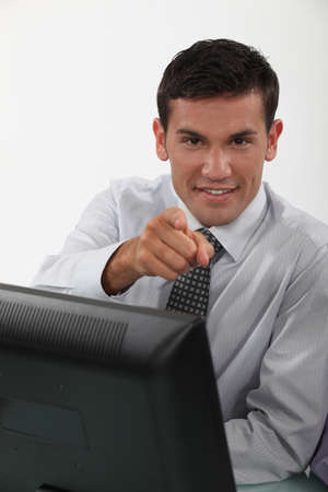 Businessman sat at desk pointing Stock Photo - 12132500