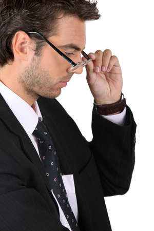 businessman putting on his glasses Stock Photo - 12132518