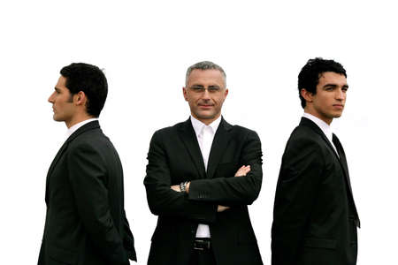 Three confident men standing on white background photo
