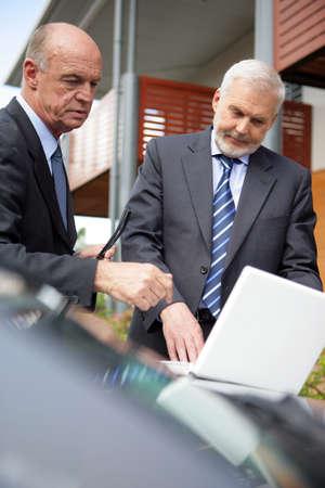 corporative: Two senior businessmen on house call Stock Photo