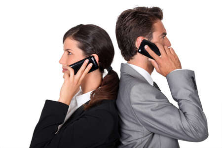 businessman and businesswoman telephoning photo