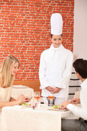 critique: Couple complimenting the chef on her cooking