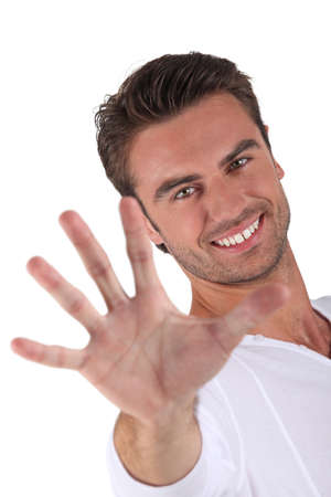Young man holding out hand photo