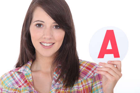 thumb keys: Young women holding learner plate Stock Photo