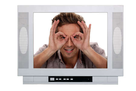 Man making a silly face inside a television frame photo