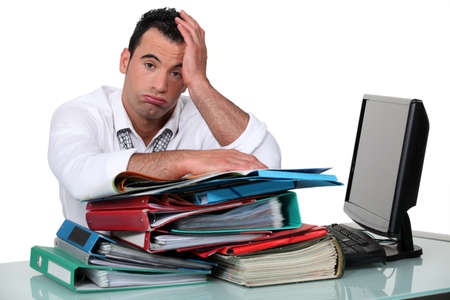 overwhelm: Overworked office worker Stock Photo