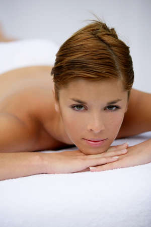 Woman laying on table waiting for massage photo