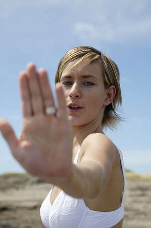 Woman holding her hand out to say stop photo