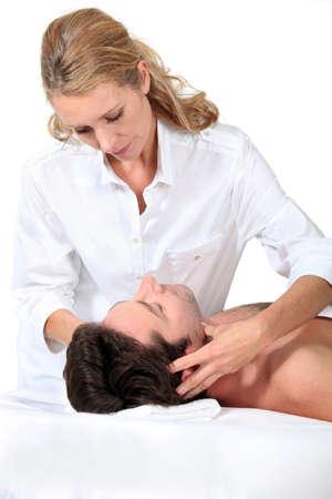 settle back: Man having a massage