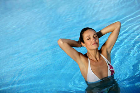 natural pool: Gorgeous woman in a swimming-pool