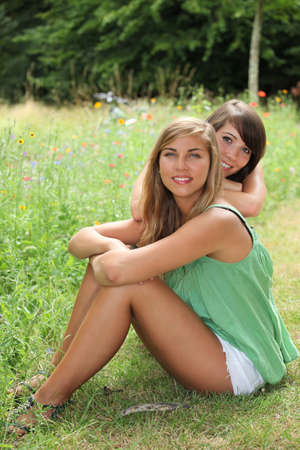 damsel: Friends sitting in a field