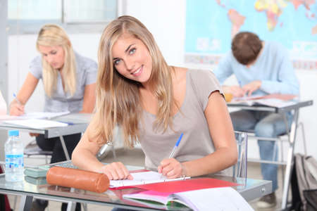 Female student at work in the classroom photo