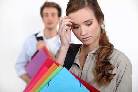 shy woman: thoughtful young student