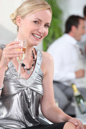 30 40: Woman drinking champagne in silver top
